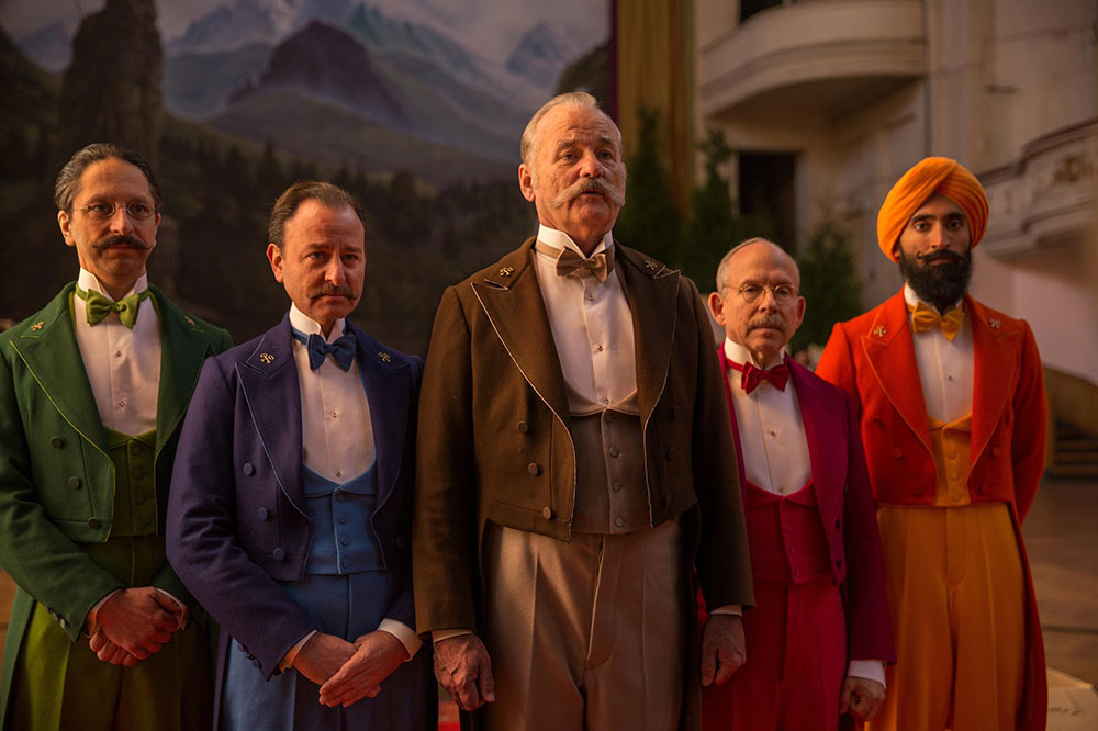 Brightly colored costume designs kept the time period of Grand Budapest Hotel ambiguous
